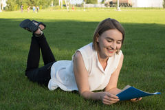 Girl in the park. With documents Royalty Free Stock Photography