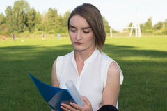 Girl in the park. With documents Royalty Free Stock Photos