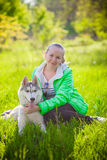 Girl in the park dog Husky Stock Images