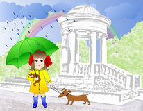 Girl in the park with a dog and a kitten. Girl strolling through the park with a dog dachshund,  had saved kitten from the rain Stock Photo