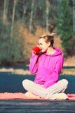 Girl at park drinking tea. Stock Photos
