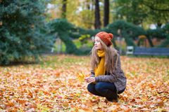 Girl in park on a fall day Royalty Free Stock Photo