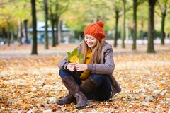 Girl in park on a fall day Stock Photo