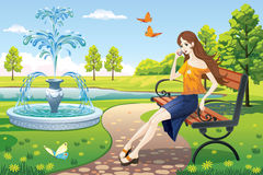 The girl in the Park by the fountain. Girl sitting on a Park bench next to the fountain Royalty Free Stock Photos