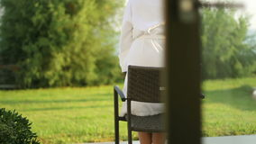 The girl in the Park in front of the House stock footage