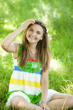 Girl in the park at green grass. Royalty Free Stock Photography