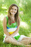 Girl in the park at green grass. Royalty Free Stock Photos