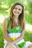 Girl in the park at green grass. Stock Photo