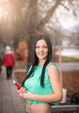 Girl in park holding book Stock Photos