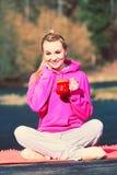 Girl at park holding mug. royalty free stock photo