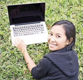 Girl in park on laptop Stock Photos
