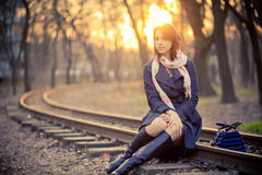 Girl in a park near the railway Royalty Free Stock Photography