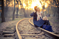 Girl in a park near the railway Royalty Free Stock Images