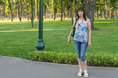 Girl in a park. A portrait of a nice girl smiling in a park Stock Photo