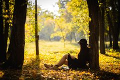 Girl in park read the book Stock Photography
