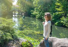 Girl in a park on the shore of the lake Stock Photography