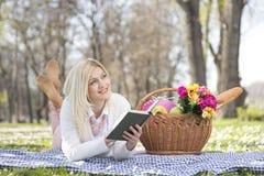 Girl in park in spring Stock Photos