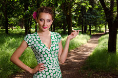 Girl in the park. Girl standing in a park near the trail royalty free stock images
