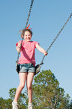 Girl on park swing Royalty Free Stock Photography