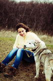 Girl in the park their home with a dog Husky. The girl with the Royalty Free Stock Photography