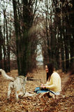 Girl in the park their home with a dog Husky. The girl with the Royalty Free Stock Photos