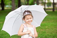 Girl in the park with umbrella Royalty Free Stock Photography