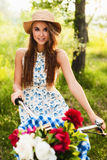 Girl in park with vintage bicycle Stock Images