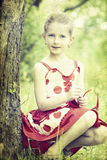 Girl in the park-vintage photo Royalty Free Stock Image