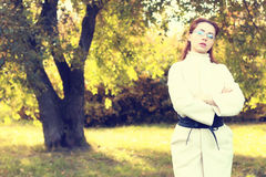 Girl in park walk autumn alone Royalty Free Stock Images