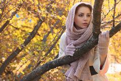 Girl in a park wear a scarf autumn royalty free stock photography