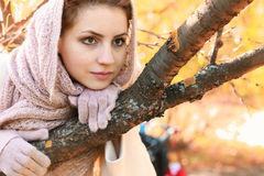 Girl in a park wear a scarf autumn Stock Image