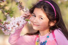 Girl in a park where flowers almonds royalty free stock images