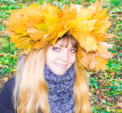 Girl in a park in Wienke of autumn leaves in the park. Close-up. Royalty Free Stock Photo