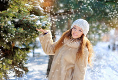 Girl in the park in winter snows Stock Photos