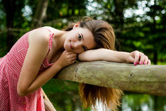 Girl in Park. A young woman in a summer park Stock Photos