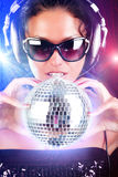 Girl is at party. Sexy female dj holding a sphere Royalty Free Stock Image