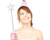 Girl in party cap with magic stick Stock Photos