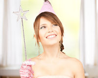 Girl in party cap with magic wand Stock Image