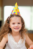 Girl with party hat Stock Image