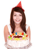 Girl in party hat holding cake. Royalty Free Stock Photo