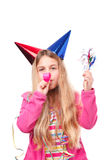 Girl with party hats and party horn blower Royalty Free Stock Photography