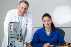Girl passed exam for fixing computer. Girl passed her exam for fixing computer Royalty Free Stock Image