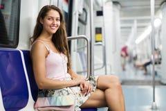 Girl passenger inside train Stock Photography