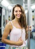 Girl passenger inside train Stock Photo