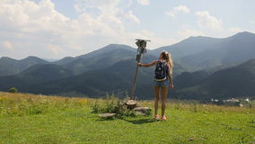 The girl passes by the pointer in the mountains stock video footage