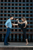 Girl passionate dance put her foot on his chest guy. Stock Photo