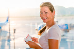 Girl with a passport and a ticket. Waiting for the plane Stock Photos