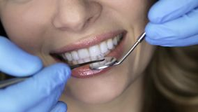 Pretty woman`s teeth examining in dental clinic