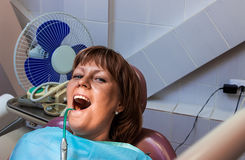Girl patient during treatment at dentist office Stock Photos