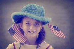 Girl Patriotic Flags Instagram Style. Detail portrait of girl with patriotic flags instagram style Stock Photo